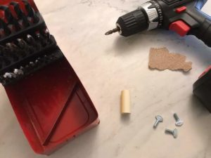 drill bit with thumb screw on table counter