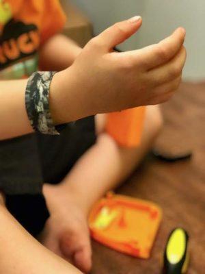 camo wristband on boys arm