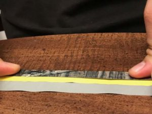 duck tape being placed on measuring tape