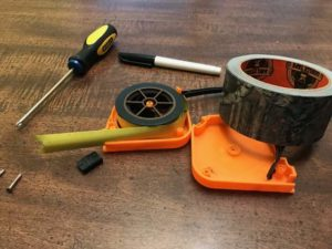 open measuring tape duck tape and screw driver