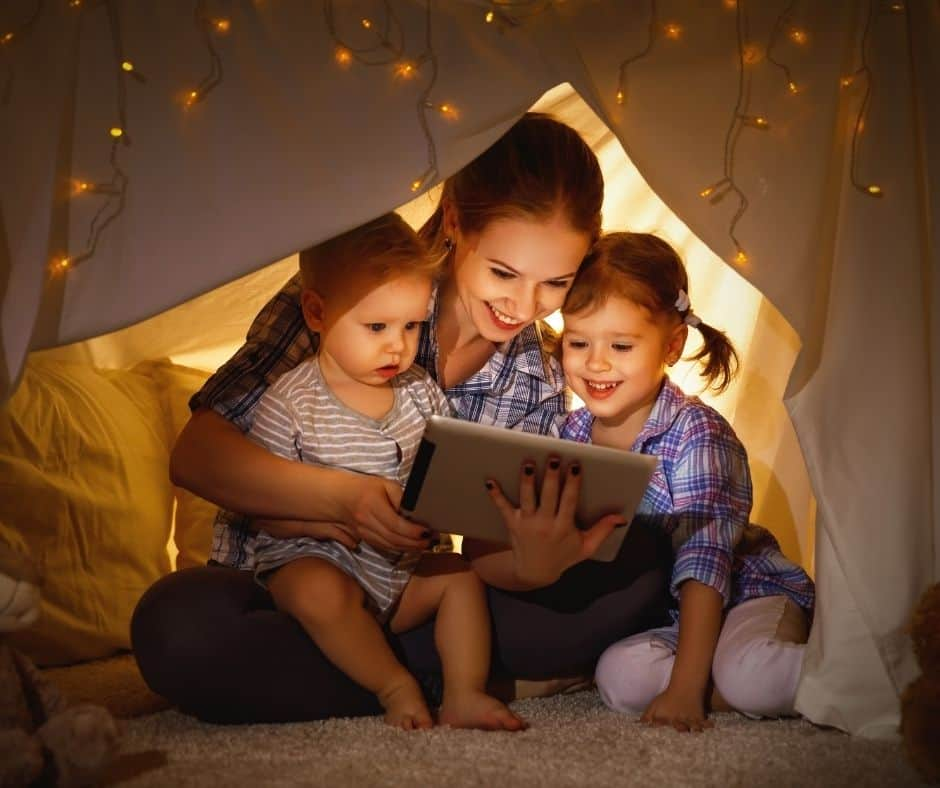 A mother and daughters watch Christian Christmas movies together.