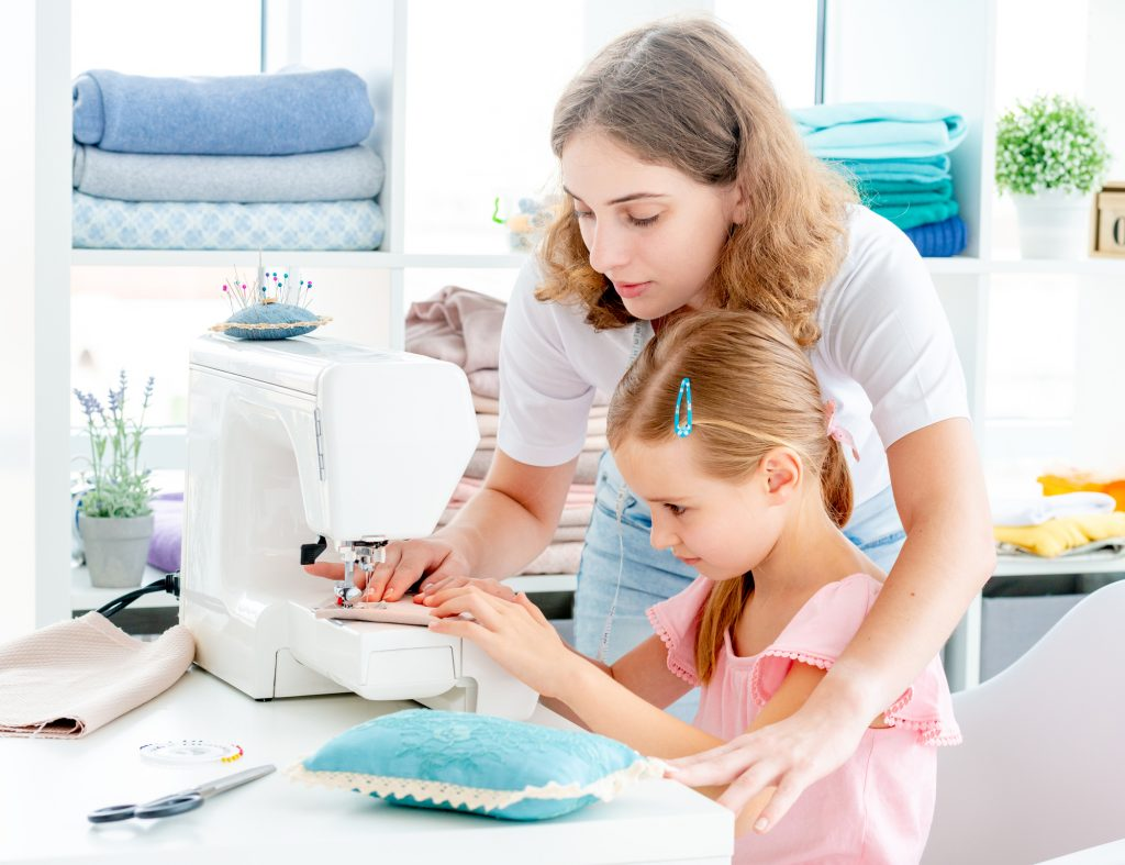 Everyone wants their children to grow up with a creative spirit and the skills necessary to do something they enjoy. Sewing is one of those hobbies that can be both fun and make for an excellent skill set. You may not know where to start when it comes to purchasing a sewing machine, or you might have some misconceptions about what types of machines are best for kids. In this article we will go over the best sewing machines for kids on the market today!