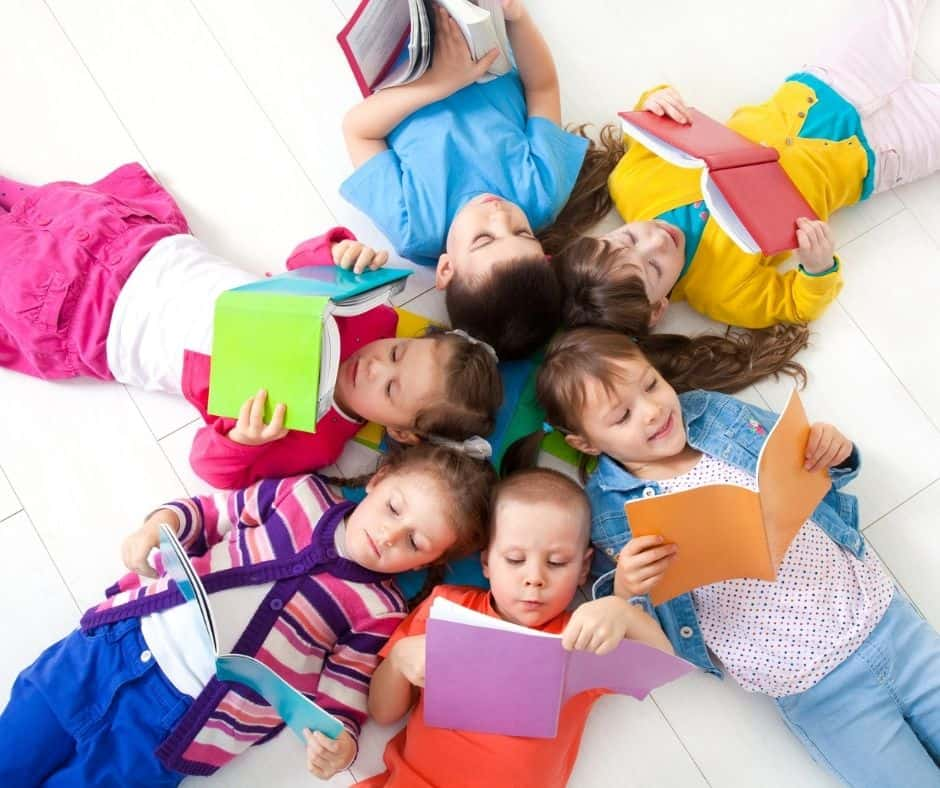 a group of second graders reading chapter books.